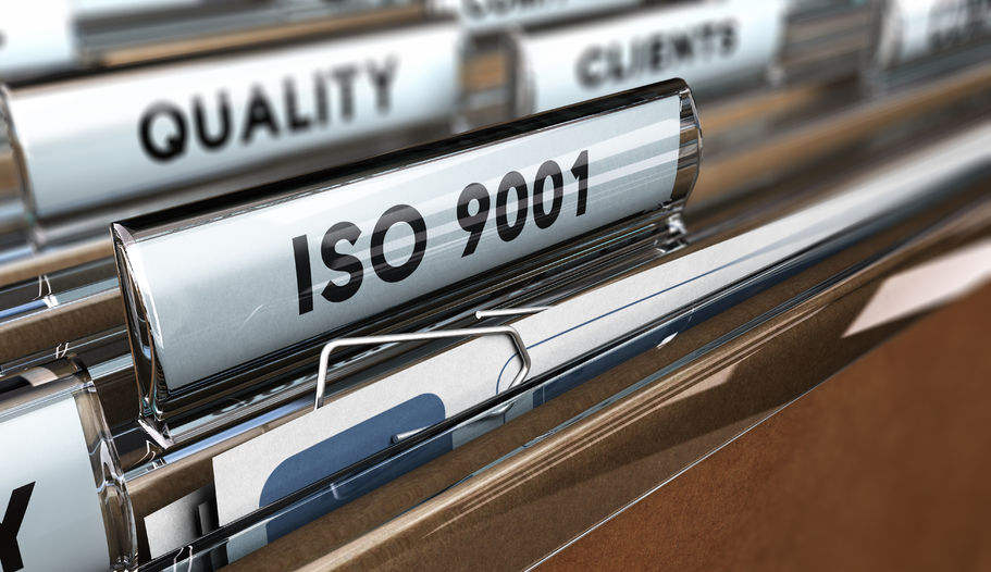 42115260 - close up on a file tab with the word iso 9001, focus on the main text and blur effect. concept image for illustration of quality standards